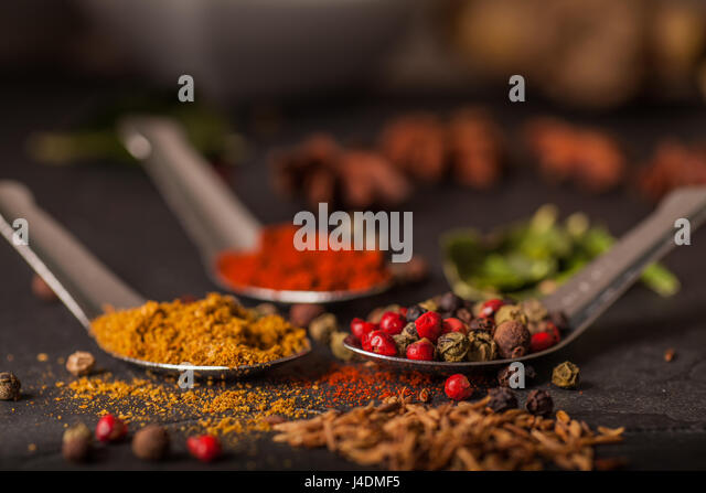 Close up of Spice selection on grey slate worktop - Stock Image