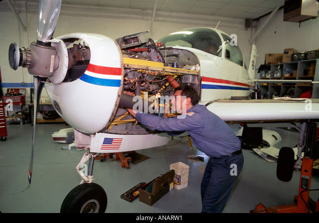 New Jersey Lincoln Park Airport airplane mechanic hangar repair flight engine - Stock Image