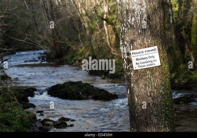 Private fishing no canoeing on river sign on the waterfalls walk, Pontneddfechan, Wales, UK - Stock Image