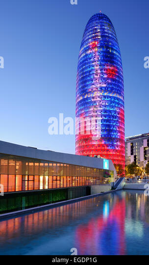 Disseny Hub Barcelona and skyscraper Torre Agbar, illuminated in the evening, architect Jean Nouvel, Barcelona, - Stock Image