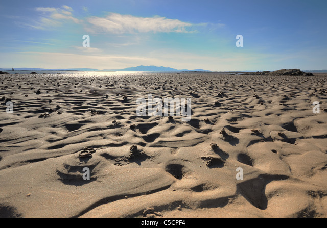 Sandy beach with the tide out, Ardrossan, Scotland, UK - Stock Image