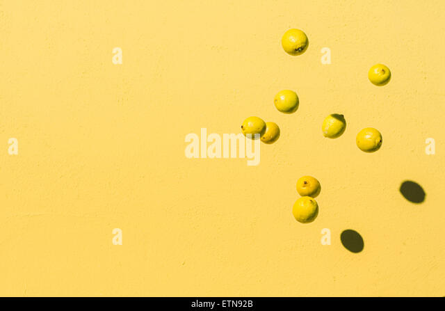 Abstract shot of lemons flying in the air - Stock-Bilder