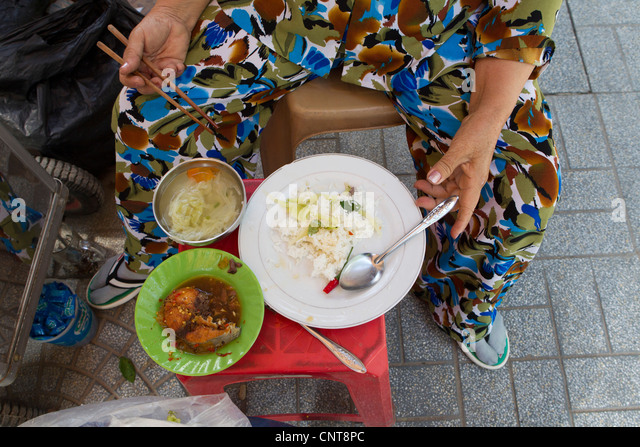 Person eating street food, cropped - Stock-Bilder