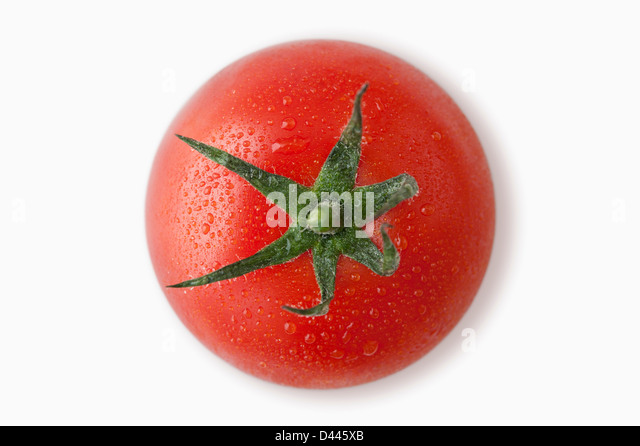 Tomato with dew on a white background, cut out, overhead - Stock Image