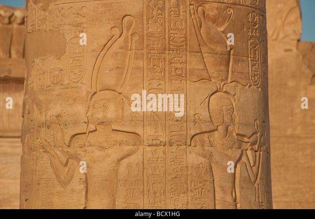 Egypt Kom Ombo temple outdoor columns pillars carving reliefs hieroglphs hieroglyphics Pharaoh offerings - Stock Image