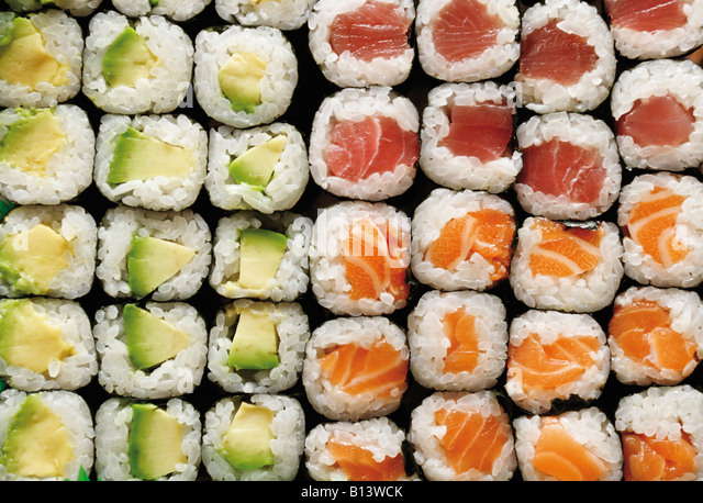 Maki Sushi made from avocados salmon and tuna full frame - Stock Image
