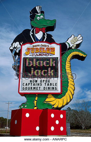 Mississippi Waveland Bayou Caddy's Jubilee Casino sign giant alligator character dice gambling black jack - Stock Image