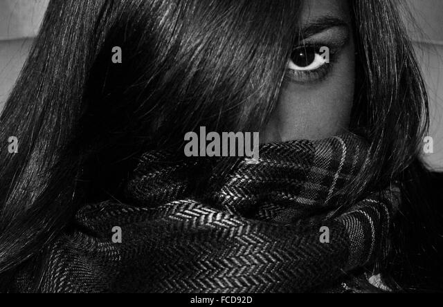 Woman Covering Her Face With Scarf And Hairs - Stock Image