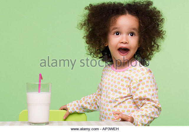 Girl with a glass of milk - Stock Image