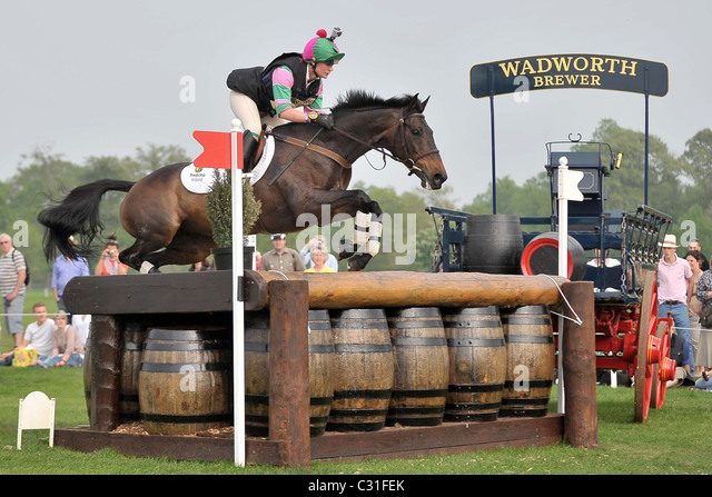Nicola Wilson riding OPPOSITION BUZZ at fence 21. Mitsubishi Badminton Horse Trials - Stock Image