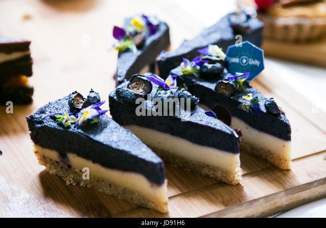 Raw vegan blueberry cake slices (Sunday UpMarket, Brick Lane, London, UK) - Stock Image