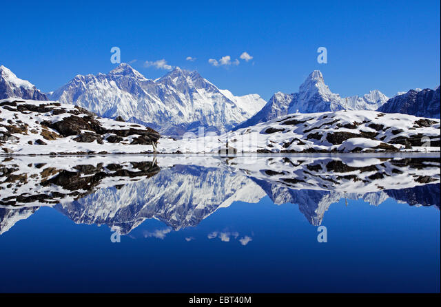 Nuptse, Mount Everest and Ama Dablam mirroring in Lake Kongde, Nepal, Khumbu Himal - Stock Image