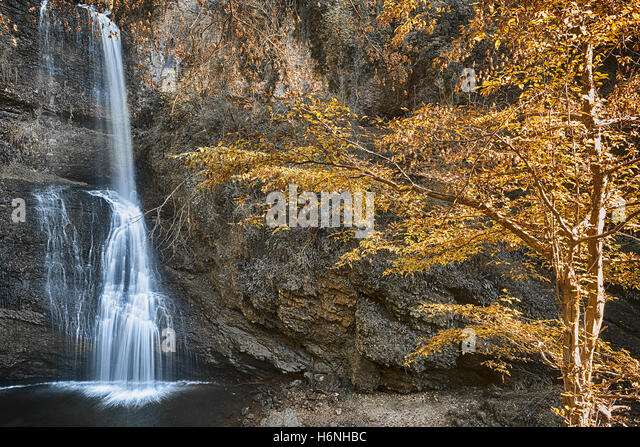 Waterfall Fermona, autumn season in the forest with hot colors of trees - Stock Image
