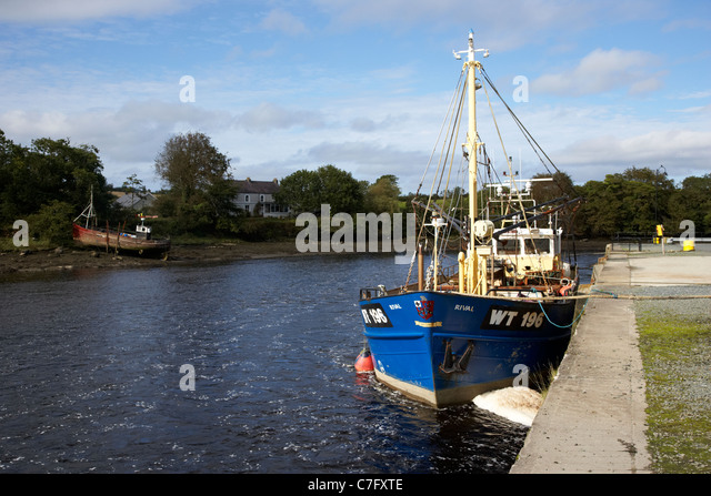 fishing boats on the quay at the river lennon ramelton county donegal republic of ireland - Stock Image