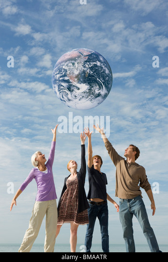 Ecology concept, group of people saving the earth together - Stock-Bilder