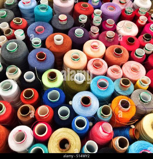 Coloured sewing threads - Stock-Bilder
