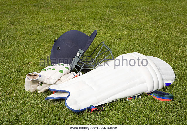 Cricket helmet pads and gloves - Stock Image
