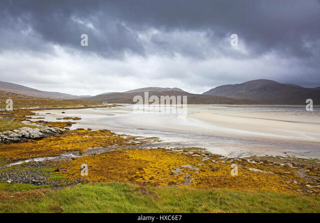 Storm clouds over tranquil view of mountains and beach, Luskentyre Beach, Harris, Outer Hebrides - Stock Image