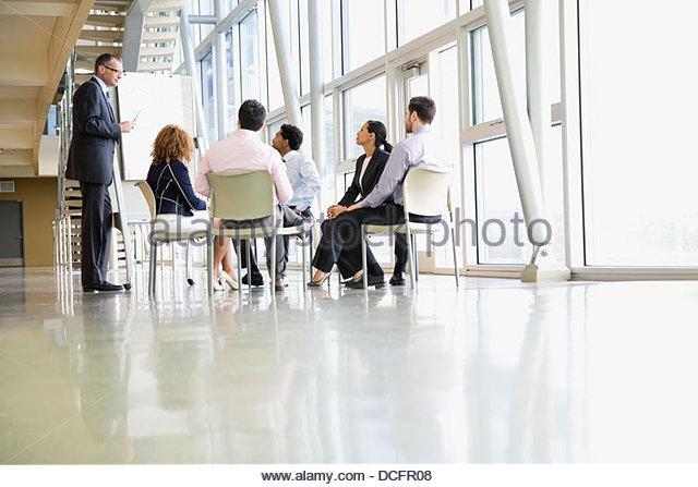 Team of business people brainstorming ideas - Stock Image