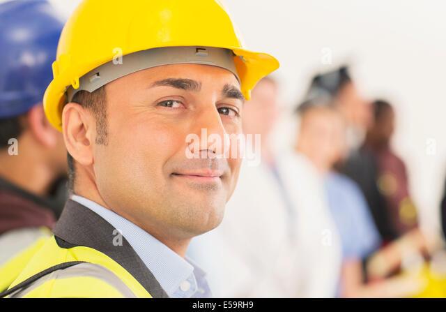 Portrait of confident construction worker - Stock Image