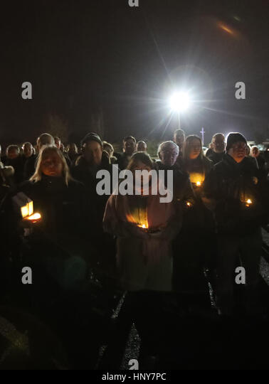 The crowd holding candles, listens as Sinn Fein's new leader at Stormont Michelle O'Neill addresses a commemoration - Stock Image