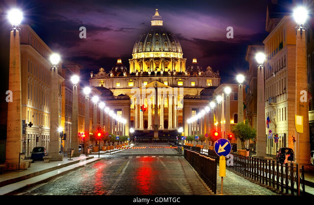 View of illuminated Saint Peter Basilica and Street Via della Conciliazione, Rome, Italy - Stock Image