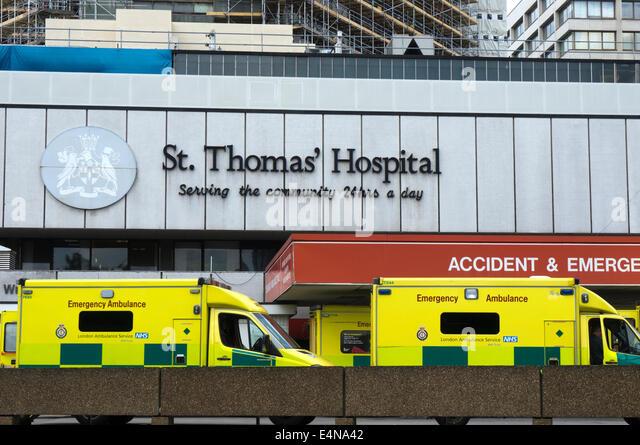 Ambulances parked outside the Accident & Emergency entrance to St Thomas' Hospital at Waterloo, London. - Stock Image