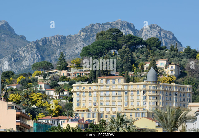 Belle Epoch Architecture and Lower Alps or Rocky Hillside Behind Menton Alpes-Maritimes France - Stock-Bilder