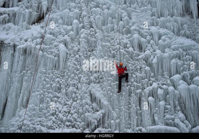 Liberec, Czech Republic. 12th Jan, 2017. A man climbs up an artificial ice wall in Liberec, Czech Republic, Thursday, - Stock Image
