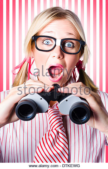 Excited Business Woman Holding Binoculars When Searching For Market Opportunities In A Coming Soon So Watch This - Stock Image