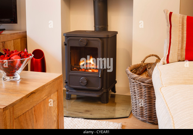 Cozy modern interior living room with wood burner - Stock Image