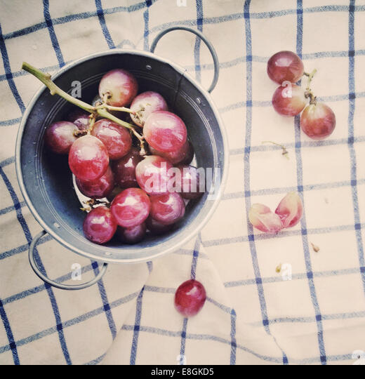 Metal bucket with grapes - Stock Image