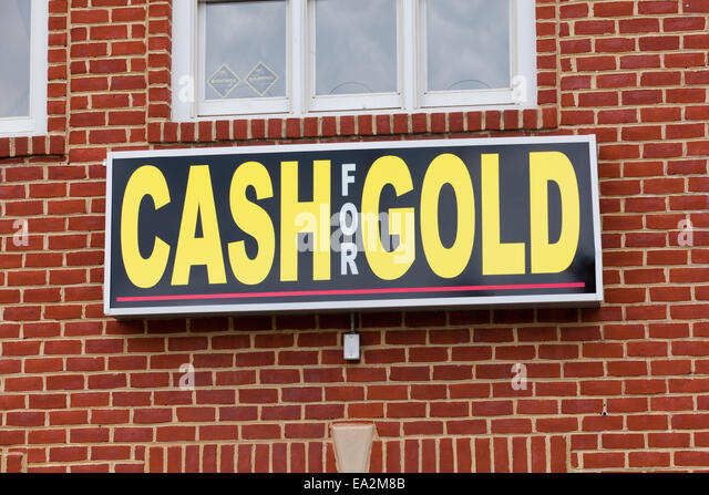 Cash for Gold sign on gold buyer store - USA - Stock Image