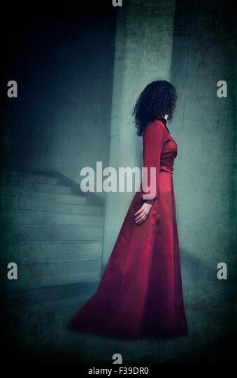 Woman in red dress - Stock-Bilder