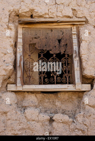 Screened window with iron grillwork, ruins of Al-Mudayrib, Sultanate of Oman - Stock Image
