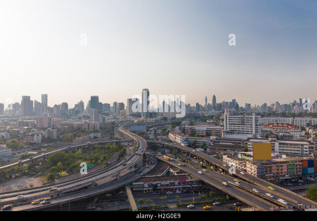 Bangkok skylines and highway traffic motion in the day time. The View from the top, Thailand. City scape and civilization - Stock Image