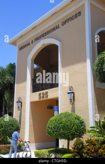 Port St. Lucie Florida Saint front entrance woman walker disabled medical and & professional offices office - Stock Image