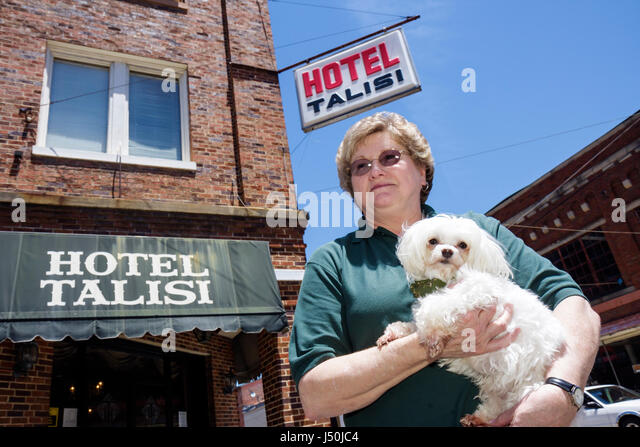 Alabama Tallasee Hotel Talisi woman senior dog Maltese white toy breed historic downtown - Stock Image