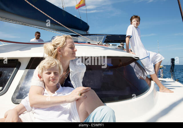 Parents and two sons sailing on catamaran near Fuerteventura, Spain - Stock Image