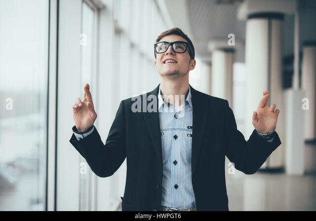 Businessman pointing up on copy space in office - Stock Image