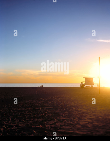 Select focus / shallow depth of field image of lifeguard hut / stand at a beach at sunset / sunrise - Stock Image