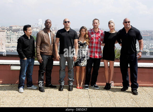 Justin Lin, left, Tyrese Gibson, Vin Diesel, Elsa Pataky, Paul Walker, Gal Gadot and Dwayne Johnson attend a photocall - Stock Image