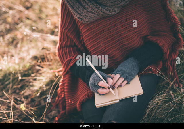 Woman writing in the notebook - Stock-Bilder