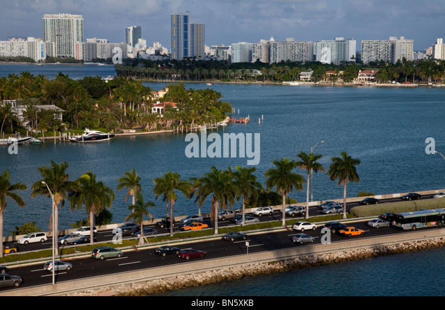 Miami Beach Florida city and bay view highway with traffic - Stock Image