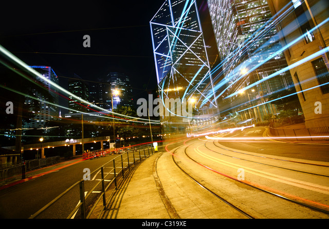 light trails on the modern building background. - Stock Image