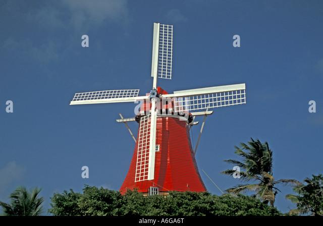 Aruba Olde Molen windmill restaurant bright red and white colors iconic aruba landmark - Stock Image
