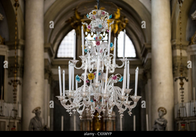 Polychrome Murano glass chandelier at the Chiesa di San Geremia in Venice - Stock Image