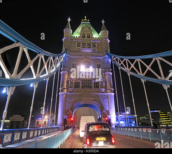 Tower Bridge Night repairs and opening traffic jam, over the Thames, London, England, with traditional black taxi - Stock Image