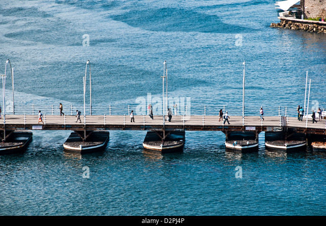 Aerial view of Queen Emma floating pontoon bridge used for pedestraian traffic across St. Anna Bay channel, Willemstad, - Stock Image