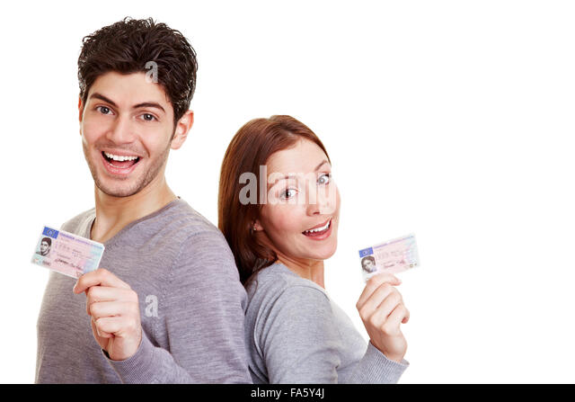 Two proud young adults with their European drivers license - Stock Image